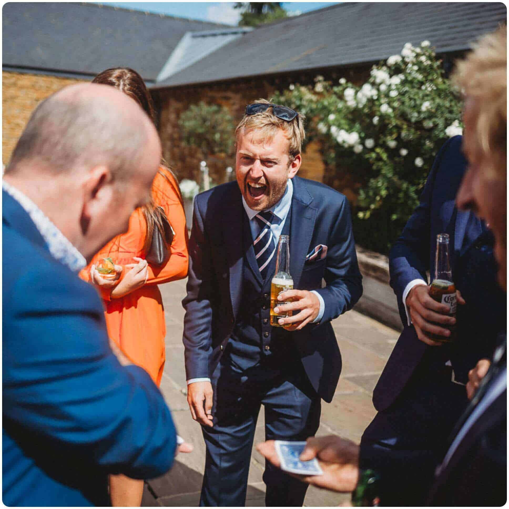 Magician Will Gray performing for wedding guests at Dodford Manor, Northampton